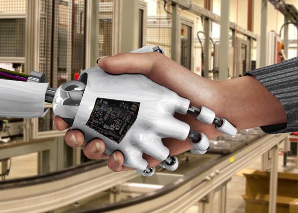 """البشر والرجال الآليون يعملون أفضل معا عبر """"التدريب المتبادل"""""""
