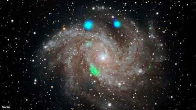 أضواء لامعة في مجرة بعيدة ترصدها وكالة ناسا